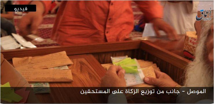 مرئي // الموصل – جانب من توزيع الزكاة على المستحقين coobra.net