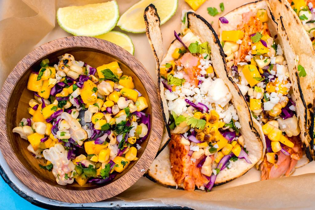 A bright and colorful salsa, filled with sweet corn, fruity mango and spicy jalapenos is the perfect addition to fish tacos.