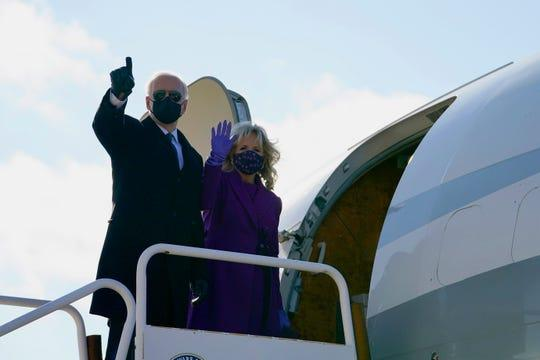 President-elect Joe Biden and his wife, Jill Biden, board a plane at New Castle Airport, Tuesday, Jan. 19, 2021, in New Castle, Delaware.