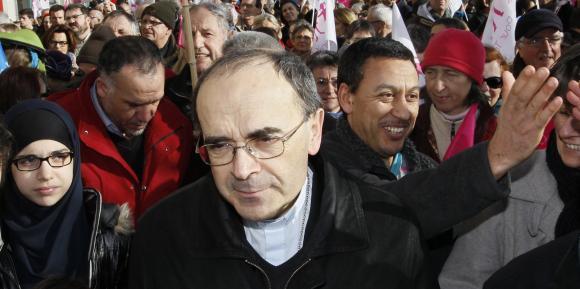 A Lyon le 2 février 2014, le primat des Gaules, lors d'une manifestation d'opposition à la loi ouvrant le mariage aux couples de personnes de même sexe. (Robert Pratta / REUTERS)