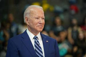 Joe Biden wearing a suit and tie: President Joe Biden waits to speak as he visits the Sportrock Climbing Centers in Alexandria, Virginia on May 28, 2021. Biden's proposed budget would increase spending to equal 25 percent of U.S. economy.