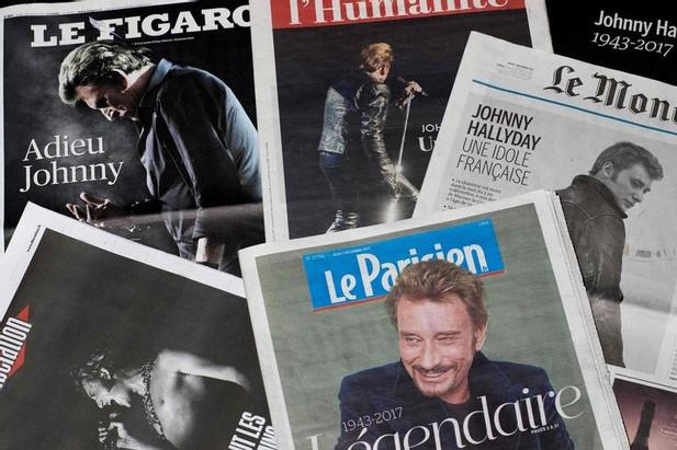 """Le Figaro"" pierwsze z lewej /AFP"