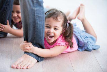 bigstock-Playful-girls-holding-father-s-92245946-370x250.jpg