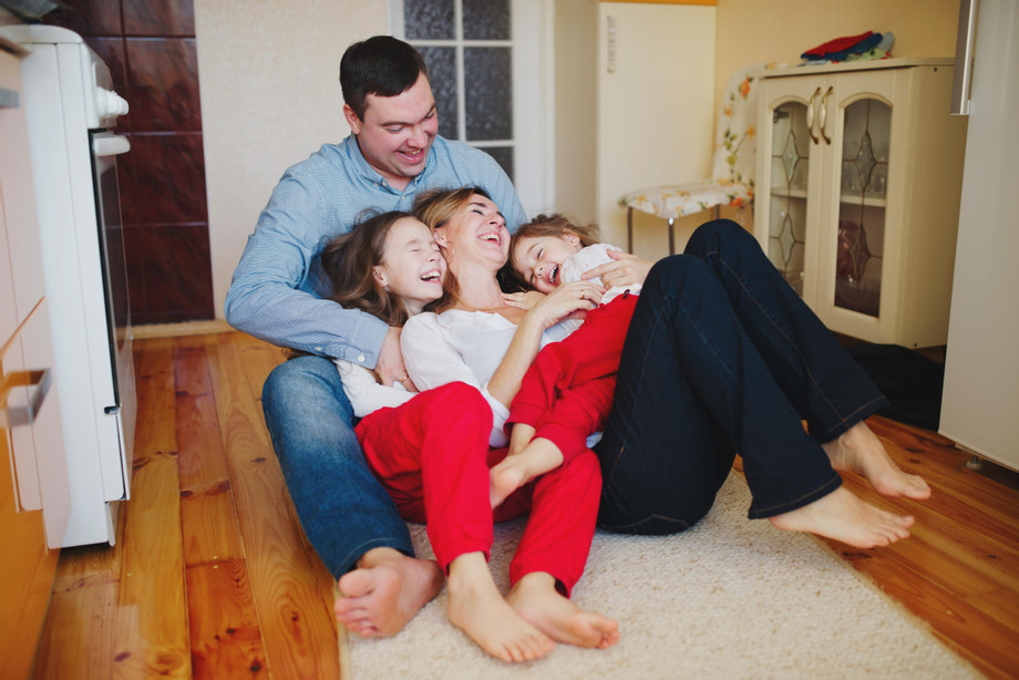 bigstock-happy-family-at-home-on-.jpg