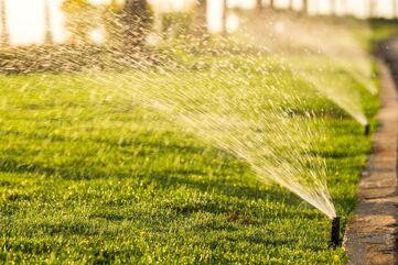 sprinklers-watering-the-grass.jpg